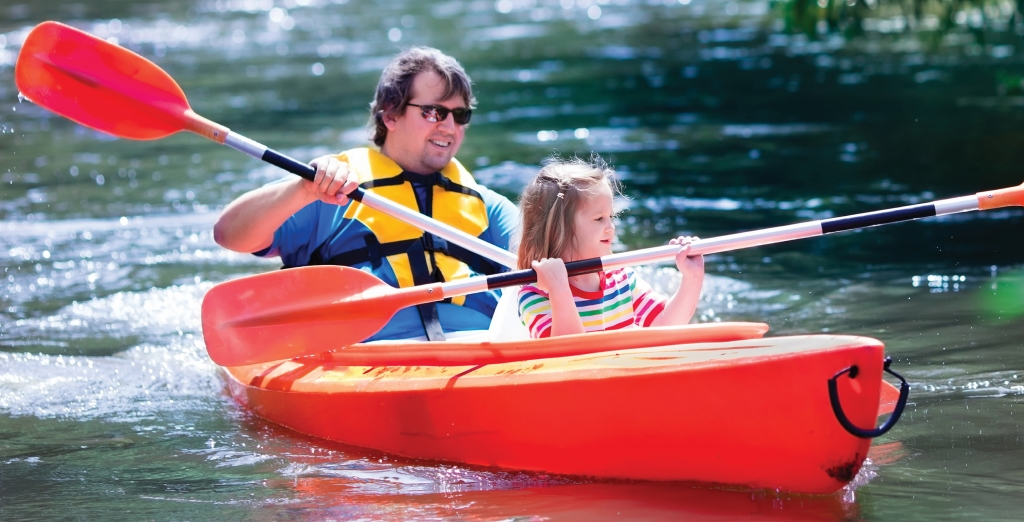 Health & Welfare Benefits: Father and Daughter Kayaking.
